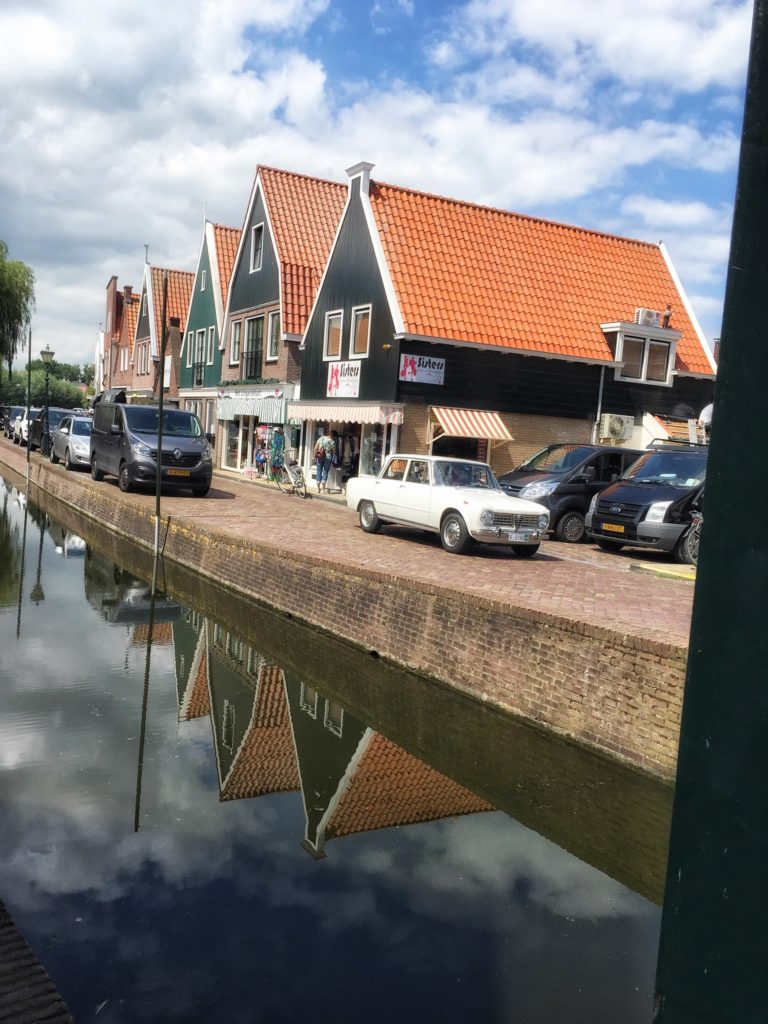 Volendam canal, nice reflections in the water, and an old Alfa Romeo.