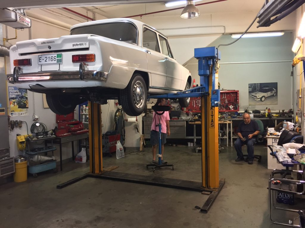 In the seller's private garage shop, changing oil.