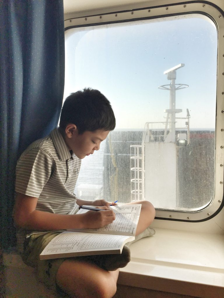 Jake working on Italian word games, on the ferry from Patras to Brindisi.
