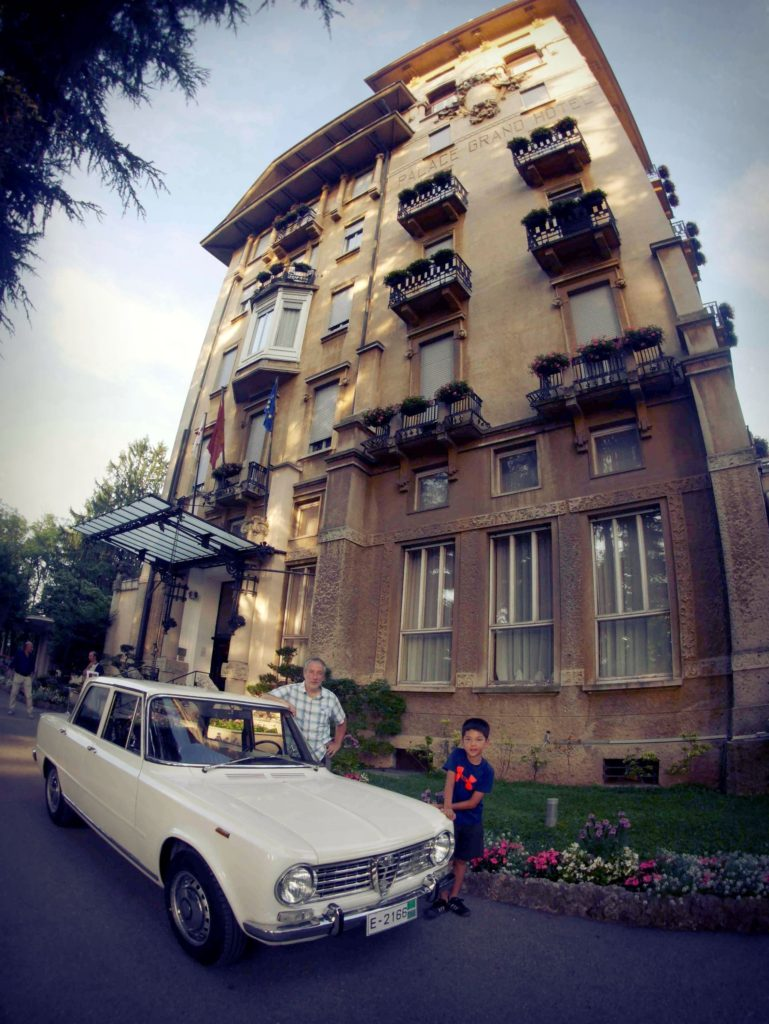 Nice car and hotel. Kid is pretty special too. The Palace Grand Hotel, Varese.