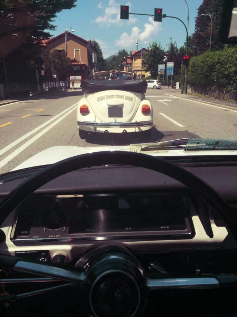 Enrico is pretty cool driving a convertible Beetle. I follow him to Mario's shop.