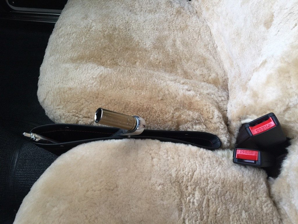 Handy pouch wedged between the seats.