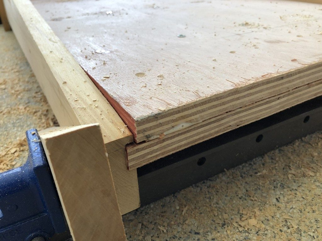 Double plywood, and the 1/4 inch recessed groove for top layer.
