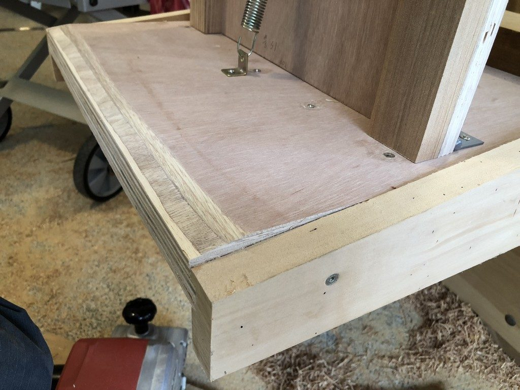 "The extra 3/4"" plywood brutally beveled with a belt sander."